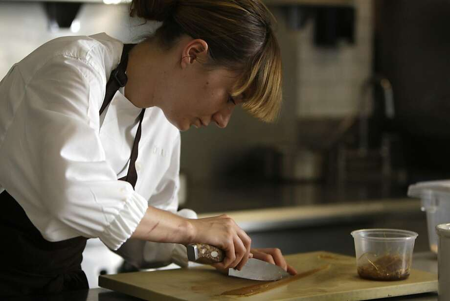 """benu chef de partie Emma Emmanuelle prepares a shark fin alternative created by benu owner and chef, Corey Lee (not shown), in the kitchen at benu in San Francisco, Calif., Friday, May 6, 2011. Modern-American restaurant Benu in San Francisco started serving """"shark fin soup"""" in August and has kept it on the tasting menu ever since. Jelling agents mimic the brittle and elastic texture of shark fin.  """"Shark fin is all about the soup itÍs cooked in; the shark has no taste,"""" said owner and chef Corey Lee. """"Certainly by looking at this alternative, you canÍt tell the difference."""" Photo: Lea Suzuki, The Chronicle"""