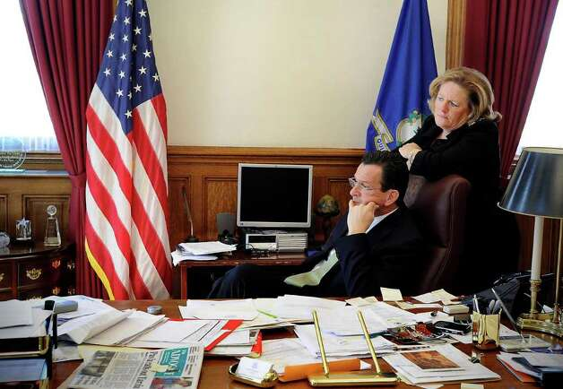 Gov. Dan Malloy in his office with his wife Cathy on the day of his budget address to a joint session of the General Assembly in Hartford, Conn. on Wednesday, Feb. 16, 2011. Photo: Kathleen O'Rourke / Stamford Advocate