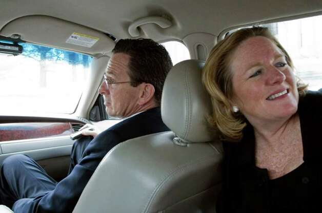 Gov. Dan Malloy and his wife Cathy in the car on the day of his budget address to a joint session of the General Assembly in Hartford, Conn. on Wednesday, Feb. 16, 2011. Photo: Kathleen O'Rourke / Stamford Advocate