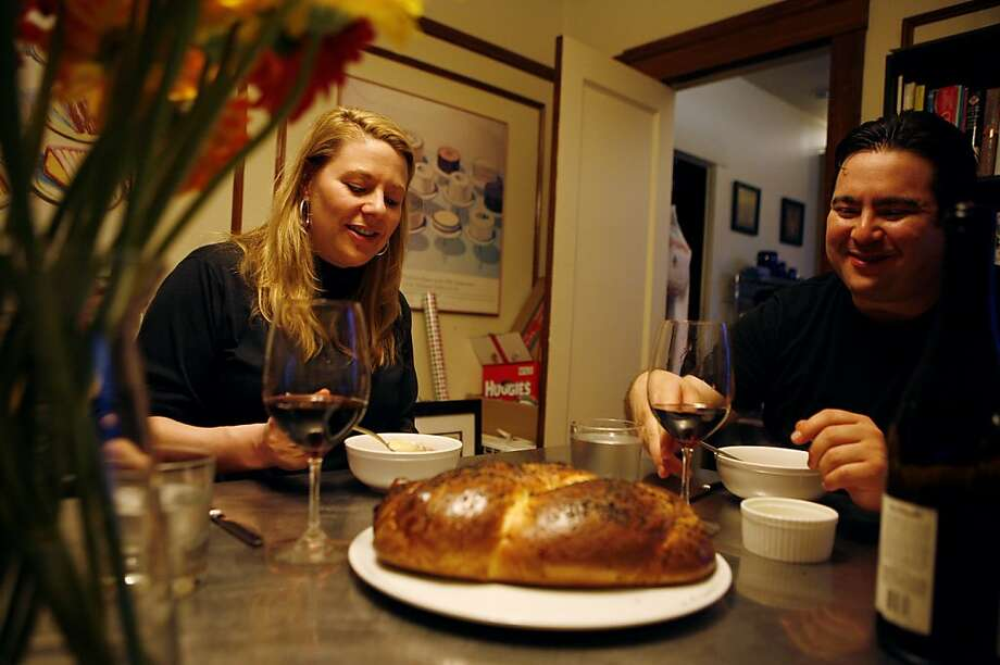 Lori Baker, (left) and husband Jeff Banker (right) sit down to dinner at their home on Monday, April 18, 2011. The two own a joint restaurant and bakery named Baker & Banker in San Francisco. Photo: Anna Vignet, The Chronicle