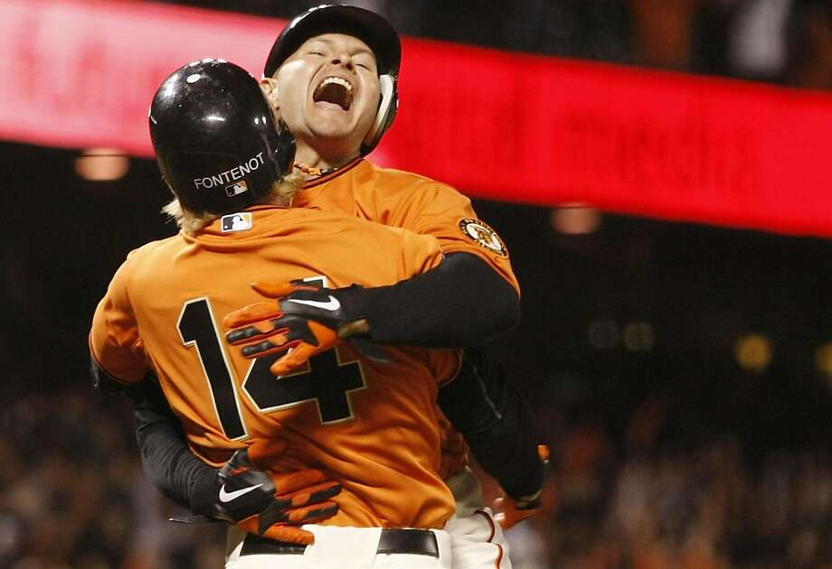 Mike Fontenot picks up Cody Ross as they celebrate the Giants win against the Rockies at AT&T Park in San Francisco Calif on Friday, May 6, 2011. Final score was 4-3. Photo: Alex Washburn, The Chronicle