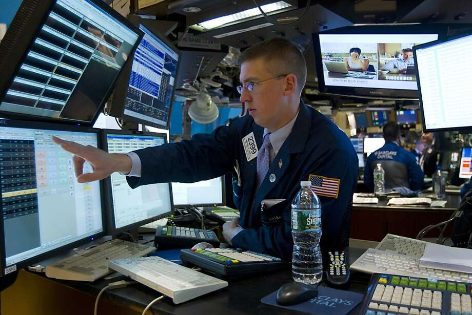 A trader works on the floor of the New York Stock Exchange in New York, U.S., on Wednesday, May 4, 2011. U.S. stocks slid, with commodity shares leading a third straight loss for the Standard & Poor's 500 Index, as a decrease in a gauge of service industries and lower-than-forecast jobs growth damped optimism in the economy. Photographer: Jin Lee/Bloomberg Photo: Jin Lee, Bloomberg