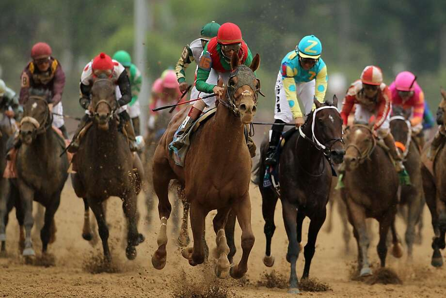 LOUISVILLE, KY - MAY 07:  Jockey John Velazquez, riding Animal Kingdom #16, runs down the front stretch towards the finish line to win the 137th Kentucky Derby at Churchill Downs on May 7, 2011 in Louisville, Kentucky. Photo: Al Bello, Getty Images