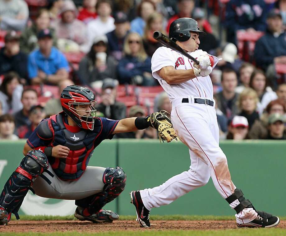 Boston Red Sox's Jacoby Ellsbury, right, hits an RBI single in front of Minnesota Twins catcher Rene Rivera in the eighth inning of a baseball game, Saturday, May 7, 2011, in Boston. Photo: Michael Dwyer, AP