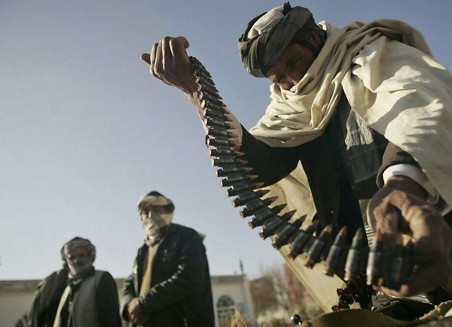 FILE- In this Dec. 28, 2010 file photo, a former Taliban fighter places a range of bullets before surrendering it to Afghan authorities, as part of a peace-reconciliation program in Herat, west of Kabul, Afghanistan. The death of Osama bin Laden is expected to spark debate within the Afghan Taliban about their ties to al-Qaida, a union the U.S. insists must end if the Afghan insurgents want to talk peace. Photo: Reza Shirmohammadi, Associated Press 2010