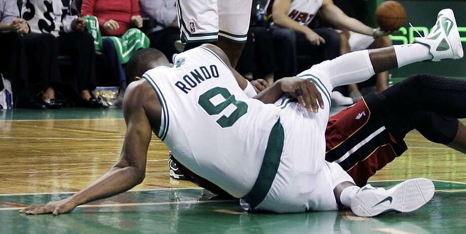 The left elbow of Boston Celtics guard Rajon Rondo dislocates his left elbow as he tangles with Miami Heat guard Dwyane Wade during the second half of Game 3 of a second-round NBA playoff basketball series in Boston, Saturday, May 7, 2011. Rondo returnedafter the injury, playing the remainder of the second half with his elbow dislocated. The Celtics beat the Heat 9-81. Photo: Charles Krupa, AP