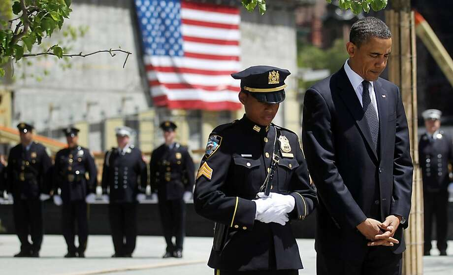 NEW YORK, NY - MAY 05:  U.S. President Barack Obama (R) bows his head during a moment of silence with New York Police Department officer Stephanie Moses (2nd R) during a wreath laying ceremony at Ground Zero, after Osama bin Laden was killed on May 5, 2011 in New York City. Obama also visited a New York Fire Department firehouse and met with families of victims of the terrorist attack on September 11, 2001during his visit to New York.   (Photo by Mario Tama/Getty Images)  *** BESTPIX *** Photo: Mario Tama, Getty Images