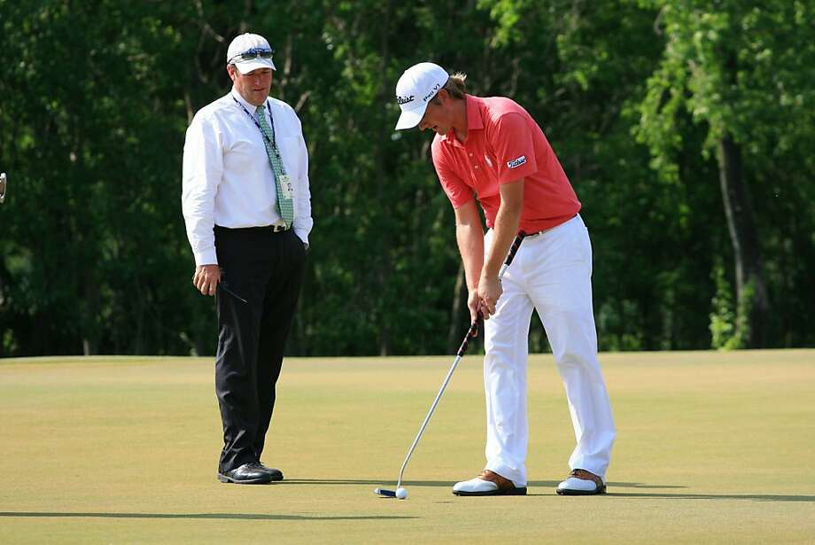 NEW ORLEANS, LA - MAY 1: Webb Simpson speaks with a rules official on the 15th green after Simpson's ball moved during the final round of the Zurich Classic at the TPC Louisiana on May 1, 2011 in New Orleans, Louisiana. Photo: Hunter Martin, Getty Images