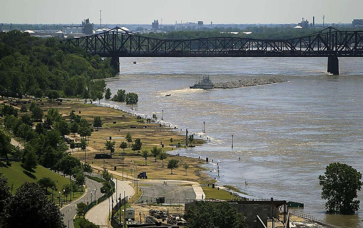 A tugboat heads under the Harahan Bridge in Memphis, Tenn., next to Tom Lee Park which is beginning to be flooded by the Mississippi River on Friday, May 6, 2011. Memphis Police began distributing more than 1,000 evacuation notices to area homeowners on Friday.