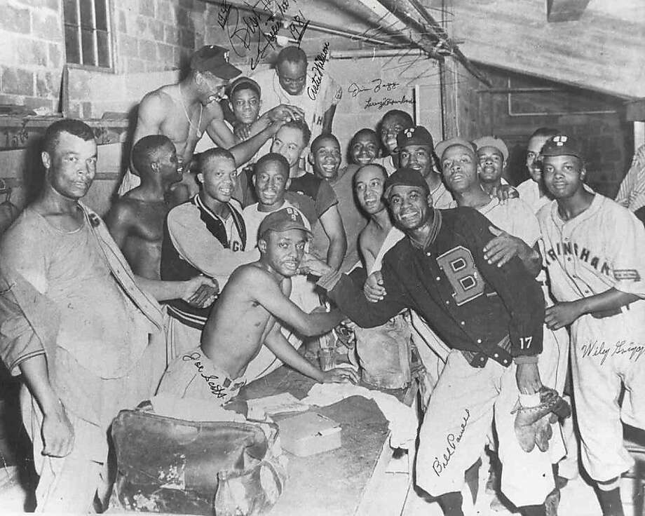 948 Birmingham Black Barons photo: the jubilant Black Barons clubhouse after they won the Negro Leagues World Series in fall 1948.  A young Willie Mays is joins the celebration (center, top row) Photo: Negro League Baseball Museum