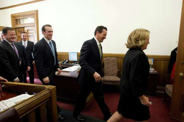 Governor Dannel P. Malloy's waits in his office with his wife Cathy Malloy and their son Dan before presenting his budget address to a joint session of the General Assembly in Hartford, Conn. on Wednesday, Feb. 16, 2011. Photo: Kathleen O'Rourke / Stamford Advocate