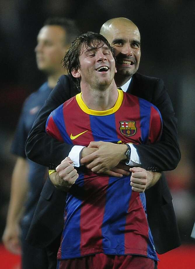 FC Barcelona's Lionel Messi from Argentina, front, and coach Josep Guardiola celebrate during a semi final, 2nd leg Champions League soccer match against  Real Madrid at the Camp Nou stadium in Barcelona on Tuesday, May 3, 2011. Photo: Manu Fernandez, AP
