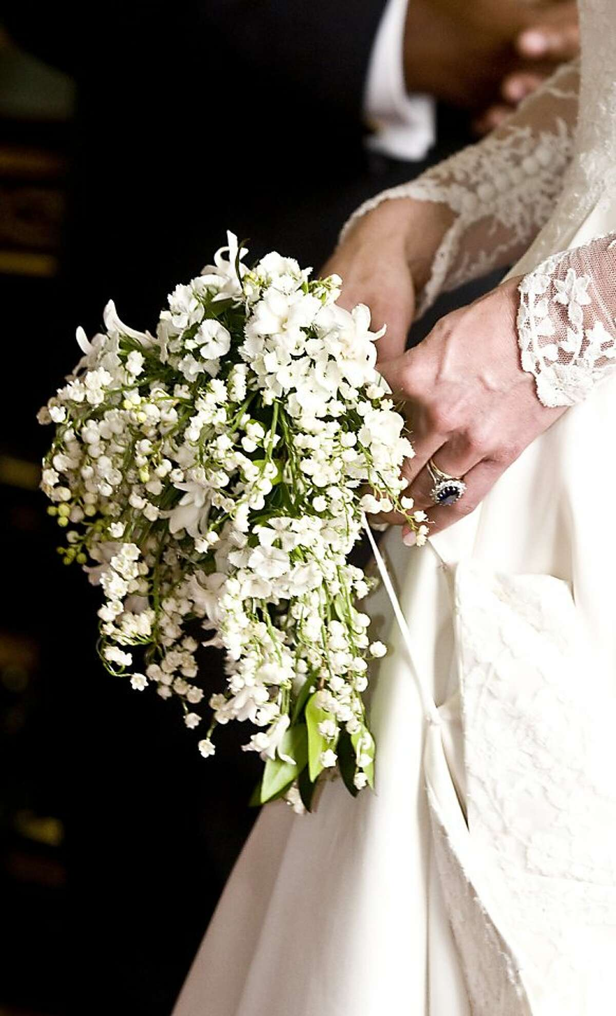A picture shows the wedding and engagement rings worn by Kate Middleton, who has been given the title The Duchess of Cambridge as she holds the bouquet of flowers of her wedding, after meeting Governors-General and Prime Ministers at Buckingham Palace onApril 29, 2011 in London .