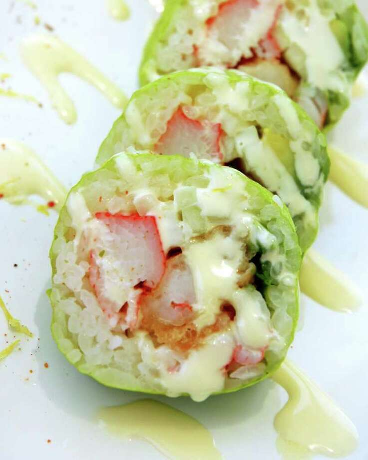 """Three virgin rolls, consisting of crab, cucumber, avocado, and shrimp, sit on a plate after being prepared by Godai chef and owner William """"Goro"""" Pitchford. Laura McKenzie/Special to the Express-News Photo: LAURA MCKENZIE, SPECIAL TO THE EXPRESS-NEWS / SAN ANTONIO EXPRESS-NEWS"""