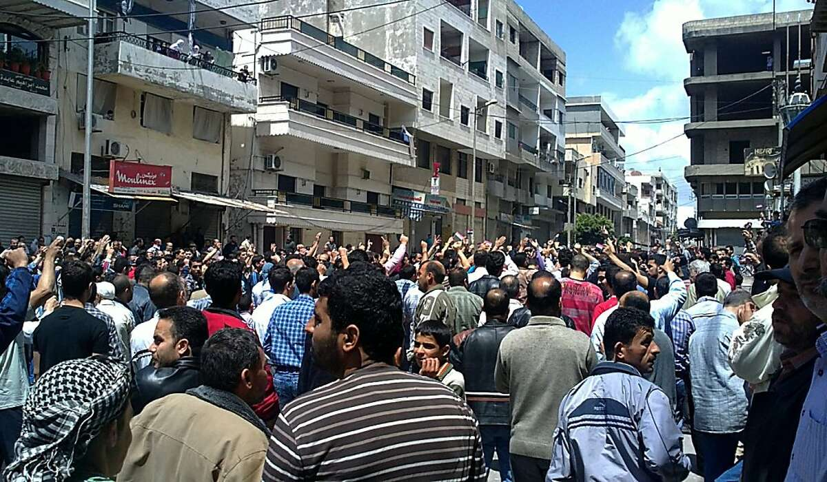 In this citizen journalism image made on a mobile phone and acquired by the AP, Syrian anti-government protesters shout slogans as they gather in the coastal town of Banias, Syria, Friday, May 6, 2011. Syrian security forces opened fire on protesters Friday, killing at least 16 people as thousands joined demonstrations across the country calling for an end to President Bashar Assad's regime, witnesses and activists said.