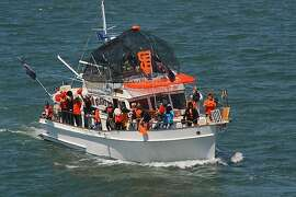 """James Purvis and his boat Sans Souci, representing Marin Yacht Club, won first place overall in the Pacific Inter-Club Yacht Association 95th Annual Opening Day Parade, themed """"Giants of the Bay,"""" May 2011."""