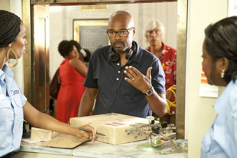 Director Salim Akil rehearses with Tasha Smith (left) and Loretta Devine in TriStar Pictures' comedy JUMPING THE BROOM. Photo: Jonathan Wenk, TriStar Pictures