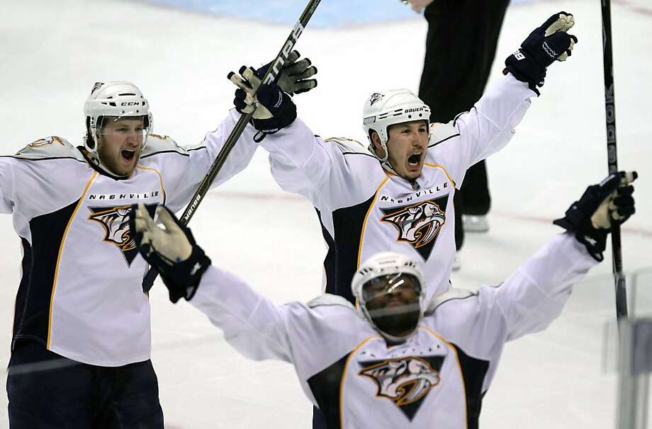 From left to right, Nashville Predators' Blake Geoffrion, Joel Ward and Jordin Tootoo celebrate Ward's goal during the third period ofGame 5 of the NHL hockey Western Conference semifinal Stanley Cup playoff series against the Vancouver Canucks in Vancouver, British Columbia, Saturday, May 7, 2011. Photo: Jonathan Hayward, AP