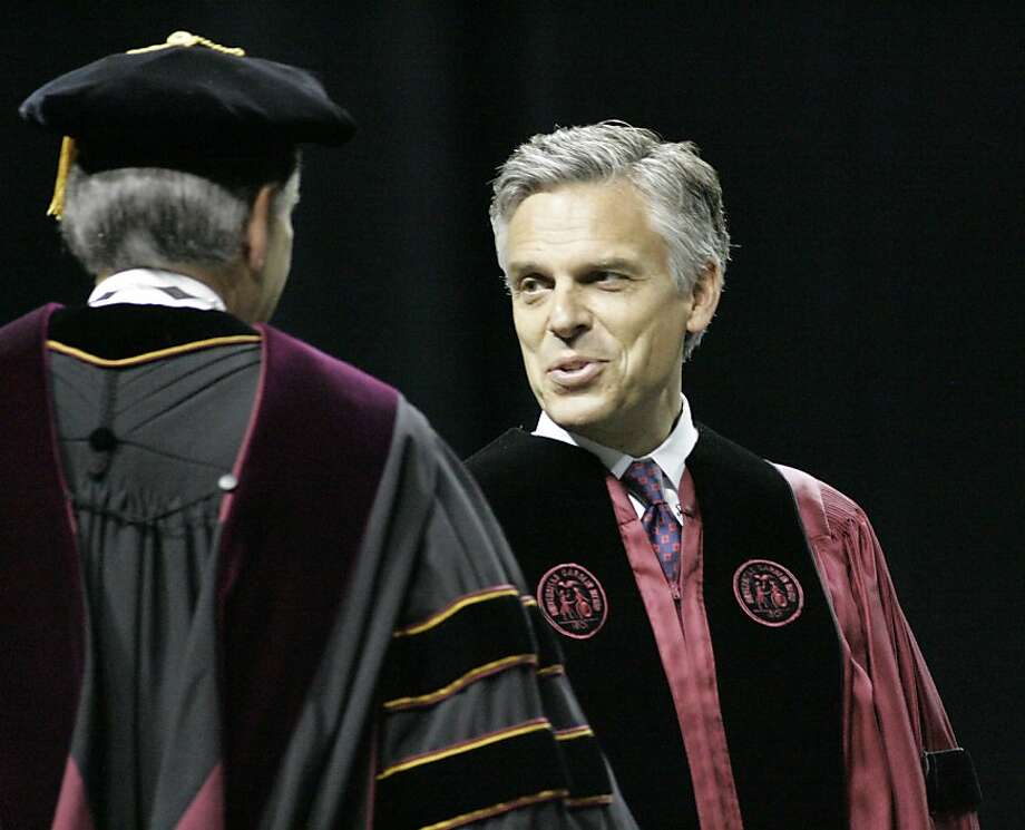 Former U.S. Ambassador to China and former Utah governor Jon Huntsman Jr. shakes hands with president Harris Pastides as he takes the podium to speak to graduates of the South Carolina Honors College and the College of Arts and Sciences during ceremoniesSaturday, May 7, 2011, in Columbia, S.C. Weighing a Republican White House bid, Huntsman used his first public appearance since stepping down as ambassador to tell students that patriotism should trump partisanship, and defended his two years in Beijing as top diplomat for a Democratic administration. Photo: Mary Ann Chastain, AP