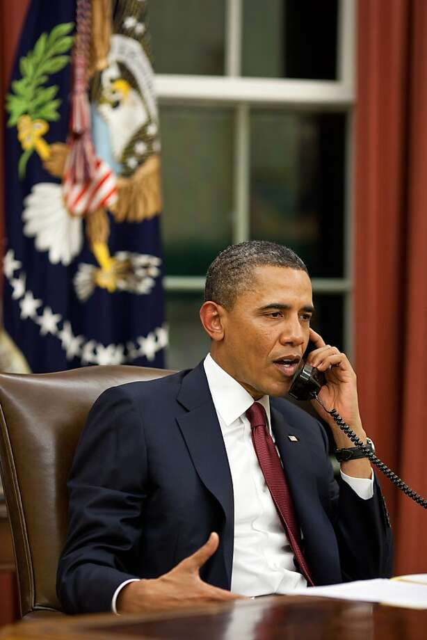 WASHINGTON, DC - MAY 1:  In this handout image provided by The White House, President Barack Obama talks on the phone in the Oval Office before making a statement to the media about the mission against Osama bin Laden, May 1, 2011 in Washington, DC. The President made a series of calls, including to Presidents George W. Bush and Bill Clinton and others, to inform them of the successful mission. U.S. President Barack Obama announced that the United States had killed the most-wanted terrorist Osama Bin Laden in an operation led by U.S. Special Forces at a compound in Abbottabad, Pakistan. Photo: The White House, Getty Images
