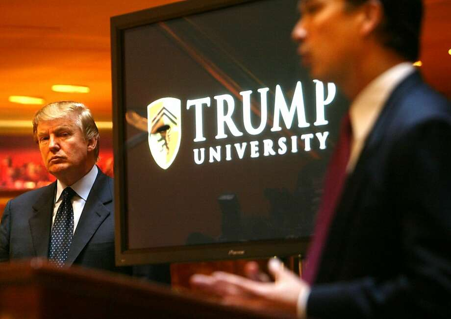 Real estate mogul and TV star Donald Trump, left, listens as Michael Sexton introduces him to announce the establishment of Trump University at a press conference in New York, Monday May 23, 2005. Sexton, who is president and co-founder of the business education company, will lead a team of scholars from Northwestern , Columbia and Dartmouth universities in providing programs for business professionals.  (AP Photo/Bebeto Matthews) Photo: Bebeto  Matthews, ASSOCIATED PRESS