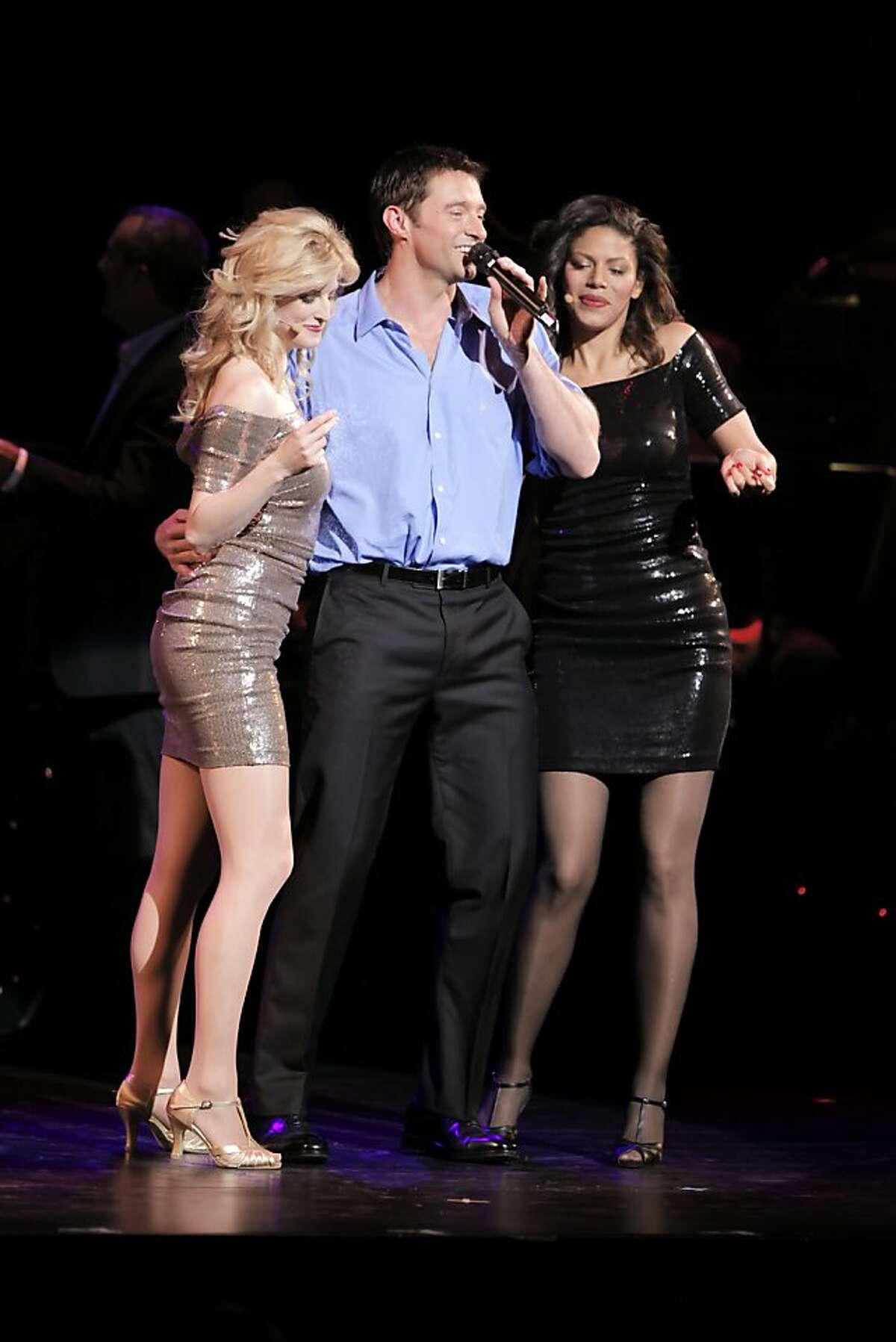 Dress rehearsal of Hugh Jackman in Performance at the Curran Theater in San Francisco, Calif., on Monday, May 2, 2011. L-R, Angel Reda, Hugh Jackman, and Merle Dandridge.