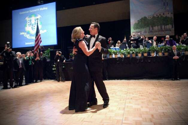 "Governor Dannel P. Malloy and his wife Cathy share their first dance during the 2011 Inaugural Ball honoring Connecticut's 88th Governor to the tune of Frank Sinatra's ""Fly Me to the Moon"" at the Connecticut Convention Center in Hartford, Conn., Wednesday evening, January 5, 2011. The ball is hosted by the Board of Trustees of the First Company Governor's Foot Guard. Photo: Keelin Daly, ST / Stamford Advocate"