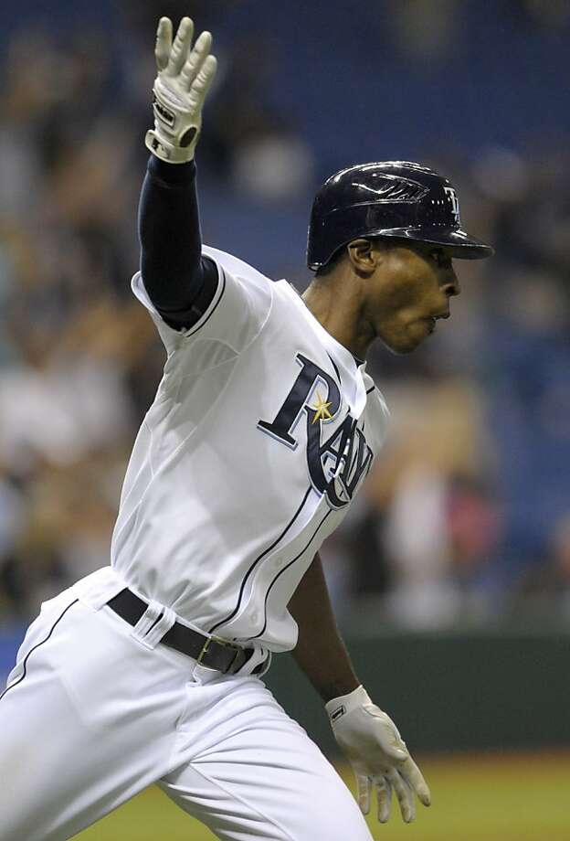 Tampa Bay Rays' B.J. Upton celebrates along the first base line after hitting a home run in the bottom of the ninth inning of a baseball game to beat the Toronto Blue Jays 3-2 in St. Petersburg, Fla., Tuesday, May 3, 2011. Photo: Phelan M. Ebenhack, AP