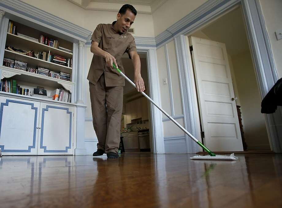Zen Home employee Carlos Andino cleans the hardwood floors of a clients home in San Francisco, Calif. Zen Home provides eco-friendly, chemical free cleaning service that provides clients with services of a 5-star hotel. They now clean homes in San Francisco and Marin Counties. Photo: Brant Ward, The Chronicle
