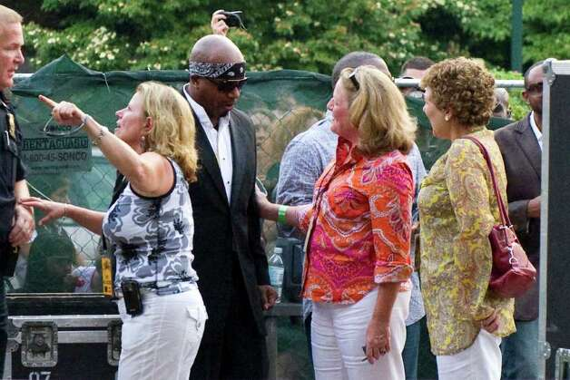 Connecticut's First Lady Cathy Malloy meets MC Hammer at Alive@Five in Columbus Park July 7, 2011. Photo: Keelin Daly, ST / Stamford Advocate