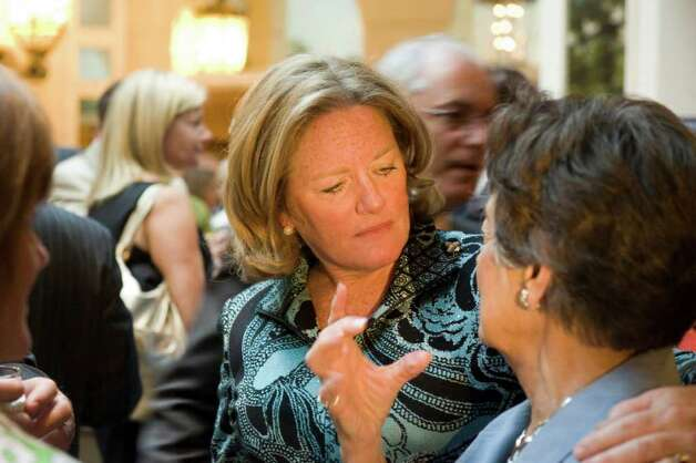 Cathy Malloy socializes at a party thrown by the Center for Sexual Assault Crisis Counseling and Education recognizing her 10 years as the agency's executive director at the Stamford Marriott Hotel & Spa in Stamford, Conn., April 14, 2011.  The party was a send off for Malloy as she moves from Stamford to Hartford. Photo: Keelin Daly / Stamford Advocate