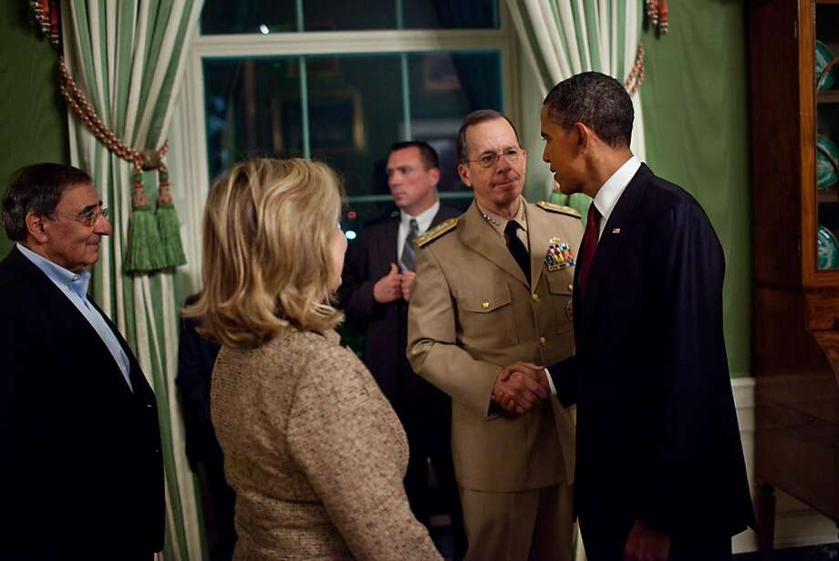 WASHINGTON, DC - MAY 1:  In this handout image provided by The White House, President Barack Obama shakes hands with Admiral Mike Mullen, Chairman of the Joint Chiefs of Staff, in the Green Room of the White House, following his statement detailing the mission against Osama bin Laden, May 1, 2011 in Washington, DC. CIA Director Leon Panetta and Secretary of State Hillary Rodham Clinton are pictured at left. U.S. President Barack Obama announced that the United States had killed the most-wanted terrorist Osama Bin Laden in an operation led by U.S. Special Forces at a compound in Abbottabad, Pakistan. Photo: The White House, Getty Images