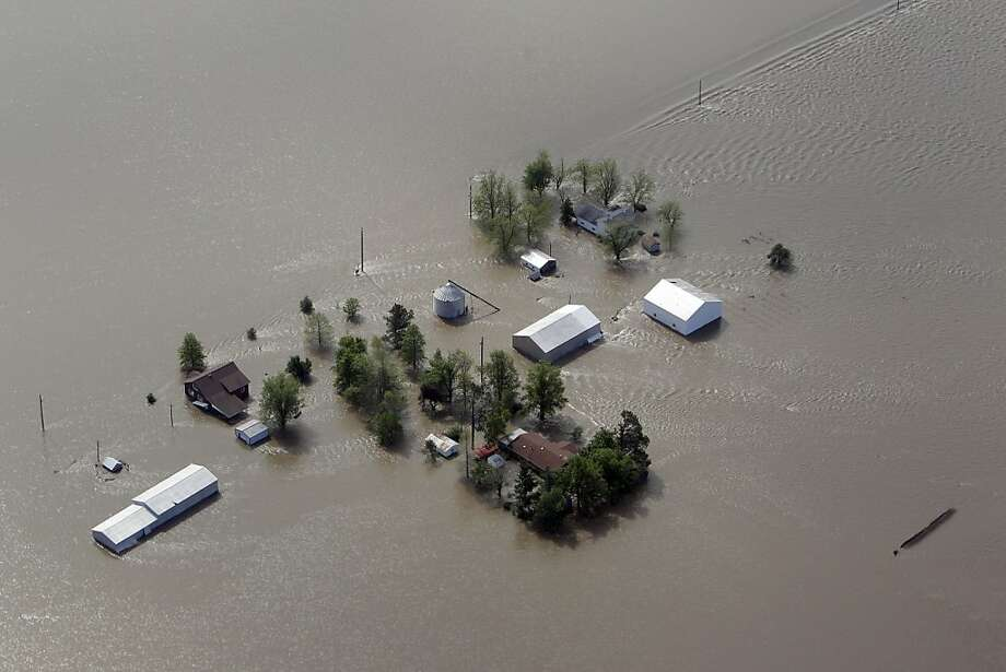 A farm is seen surrounded by floodwater Tuesday, May 3, 2011, in Mississippi County, Mo. The Army Corps of Engineers' blew a two-mile hole into the Birds Point levee in southeast Missouri, after nightfall Monday, flooding 130,000 acres of farmland in Missouri's Mississippi County in an effort to protect nearby Cairo, Ill. Photo: Jeff Roberson, AP