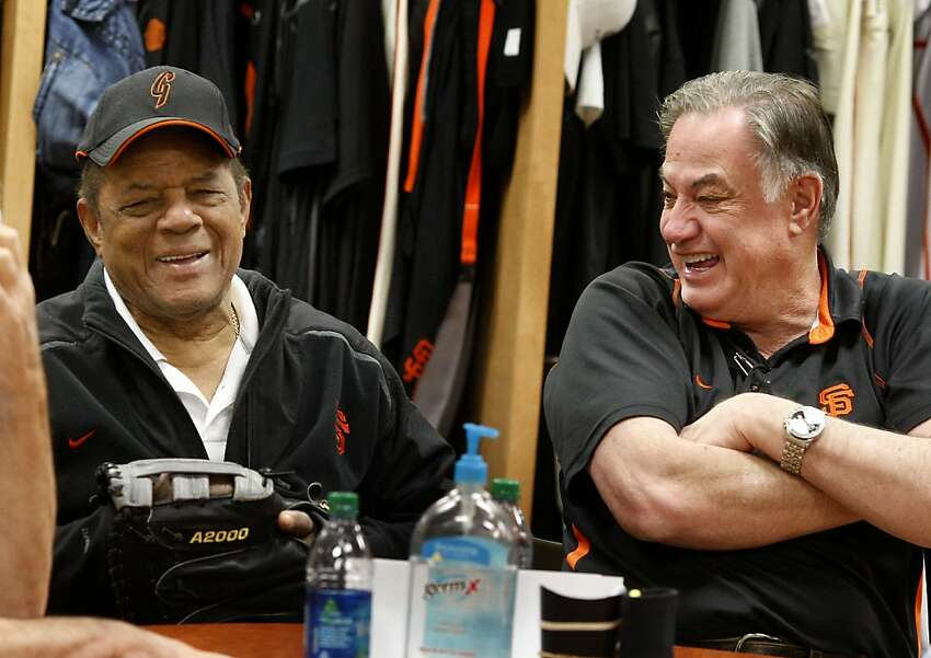Willie Mays (left) and Giants equipment manager Mike Murphy enjoy a light moment when talking about their past together. The San Francisco Giants held a workout at their Scottsdale Stadium facility Wednesday February 24, 2011 and also a short inter squad game.