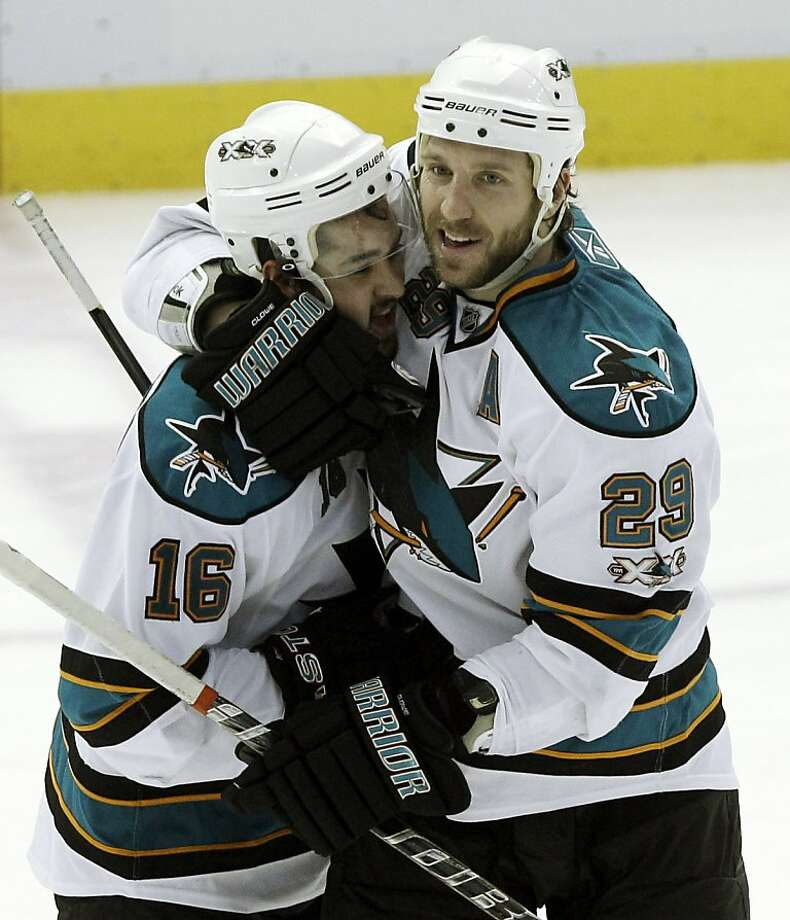 San Jose Sharks right wing Ryane Clowe (29) hugs Devin Setoguchi while celebrating Setoguchi's game winning goal in overtime against the Detroit Red Wings in Game 3 of a second-round NHL Stanley Cup playoff hockey series in Detroit, Wednesday, May 4, 2011. San Jose won 4-3 to take a 3-0 lead in the series. Photo: Paul Sancya, AP