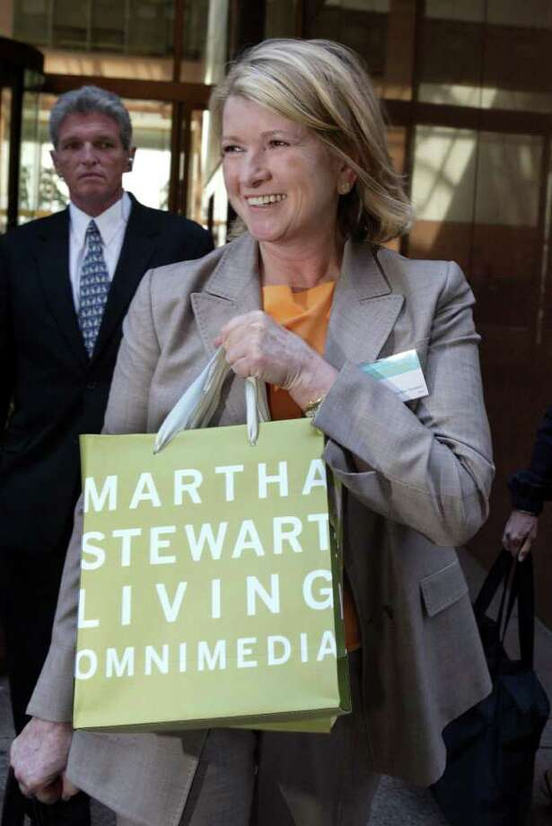 FILE - In this June 22, 2004 file photo, Martha Stewart leaves the  Martha Stewart Living Omnimedia Inc. annual shareholders' meeting, in New York. Beginning in February 2013, customers will be able to visit distinct Martha Stewart retail stores inside the majority of jcpenney department stores. These Martha Stewart stores are intended to be destinations where consumers can experience an engaging and inspiring environment and buy a variety of affordable, high-quality home and lifestyle merchandise designed and curated by Martha Stewart and her team. (AP Photo/Mary Altaffer, File) Photo: MARY ALTAFFER / AP2004