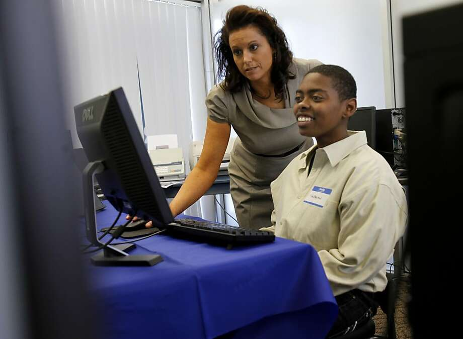 Mae'zhean Mason smiled as Career Coach Yvonne Mau helped him with his resume. The Richmond, (Calif.) Financial Opportunity Center began operations at Rubicon Programs Tuesday April 26, 2011.  Rubicon's mission is to prepare very low-income people to achieve financial independence. Photo: Brant Ward, The Chronicle