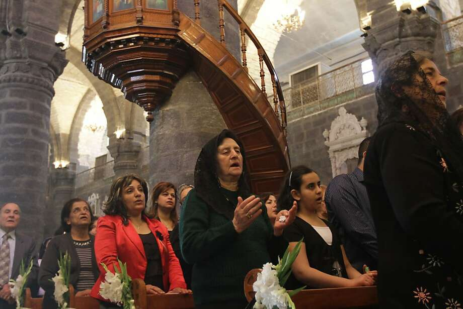 EDS NOTE- PHOTOGRAPH WAS TAKEN WITH THE APPORVAL OF GOVERNMENT OFFICIALS-- Syrian Christians sing hyms during Sunday service at the Greek Catholic Church of Our Lady Al-Niyah in Damascus on May 01, 2011, as the Syrian government cracksdown on protesters across the country calling for a change of regime. Photo: Louai Beshara, AFP/Getty Images