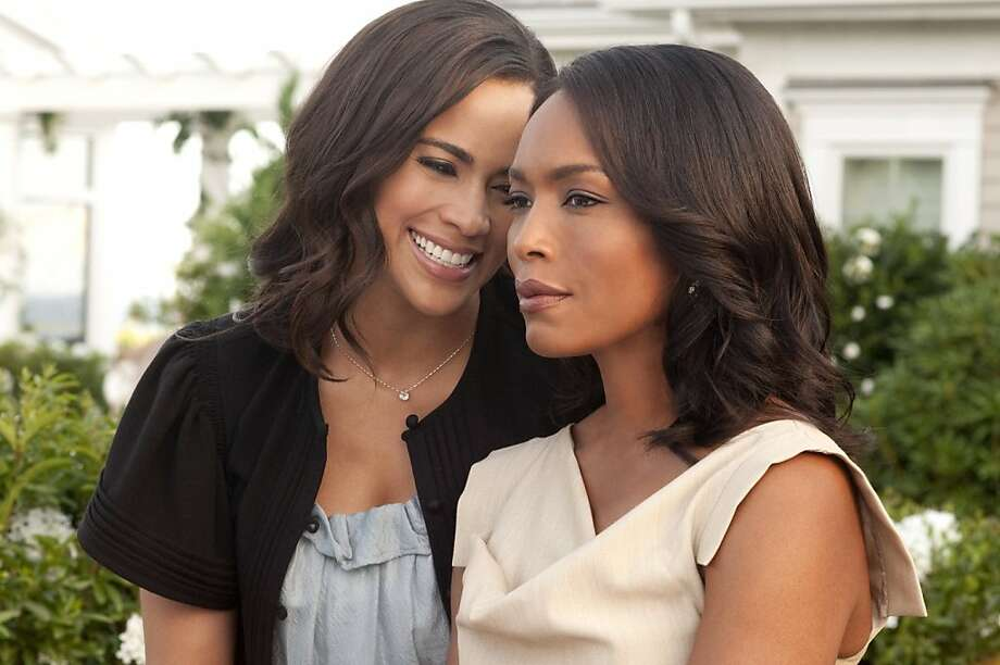 Paula Patton (left) and Angela Bassett star in TriStar Pictures' JUMPING THE BROOM. Photo: Jonathan Wenk, TriStar Pictures