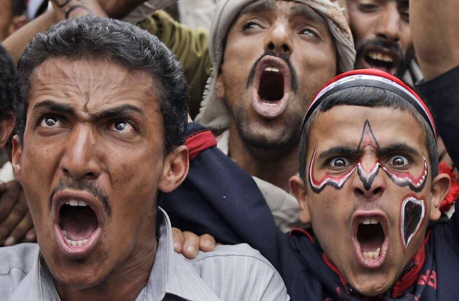 Anti-government protestors shout slogans during a demonstration demanding the resignation of Yemeni President Ali Abdullah Saleh, in Sanaa,Yemen, Thursday, May 5, 2011. Yemen, which is currently wracked by the popular protests against the country's deeply unpopular president, is also home to one of the most active branches of al-Qaida, which has planned several attacks against the U.S.  (AP Photo/Hani Mohammed) Photo: Hani Mohammed, AP