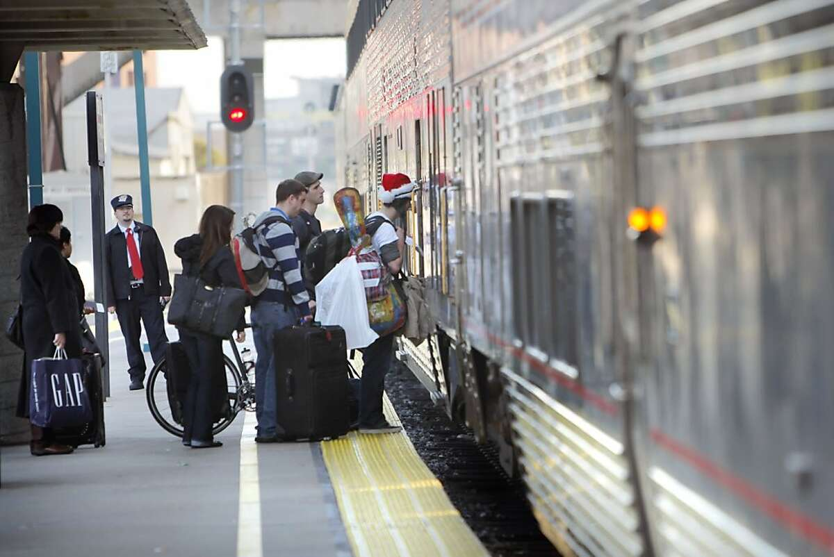 Passengers board the eastbound Capitol Corridor Amtrak train in Emeryville. While high-speed rail in California is getting all the attention, the state's lower-speed intercity trains are seeing a boom in popularity. Trains like the Capitol Corridor, shown here on Thursday, December 23, 2010, in Emeryville, Calif., have seen a double digit rise in passengers.
