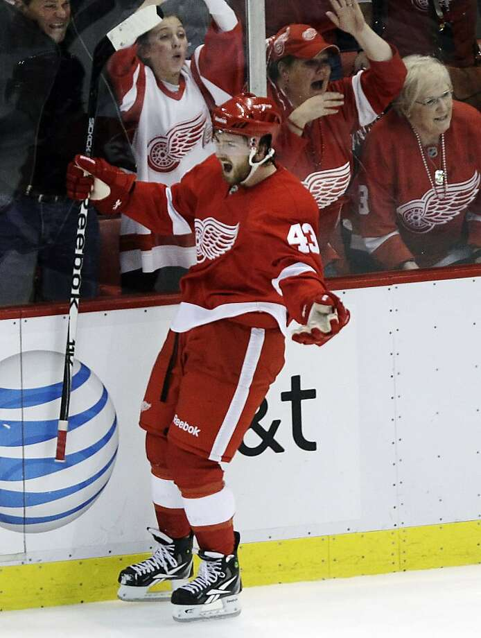 Detroit Red Wings' Darren Helm celebrates scoring the game-winning goal against the San Jose Sharks during the third period in of Game 4 of a second-round NHL Stanley Cup playoffs hockey series, Friday, May 6, 2011 in Detroit. Detroit won 4-3, but the Sharks lead the series 3-1. Photo: Paul Sancya, AP