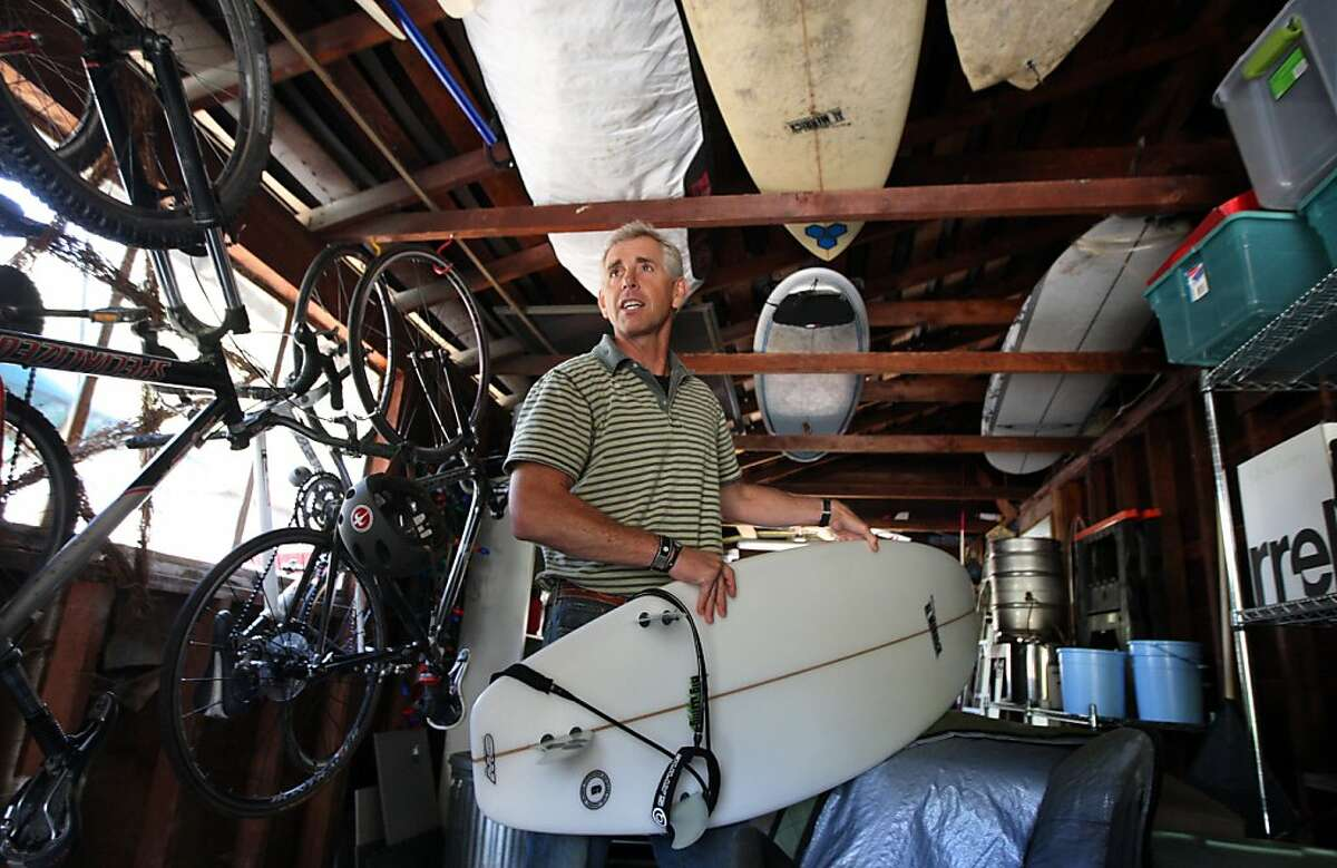 KTVU meteorologist Bill Martin pulls down his newist surf board from the rafters of his garage. Nightly he gives his viewers both Bay-Area and the national weather reports but his hart is with the surf report. The UC Berkeley grad and longtime Bay Area resident grew up in the Bay Area, on his surfboard, now with an advantage being an AMS certified meteorologist he knows where to go and what to expect when he gets there Thursday, April 28, 2011.