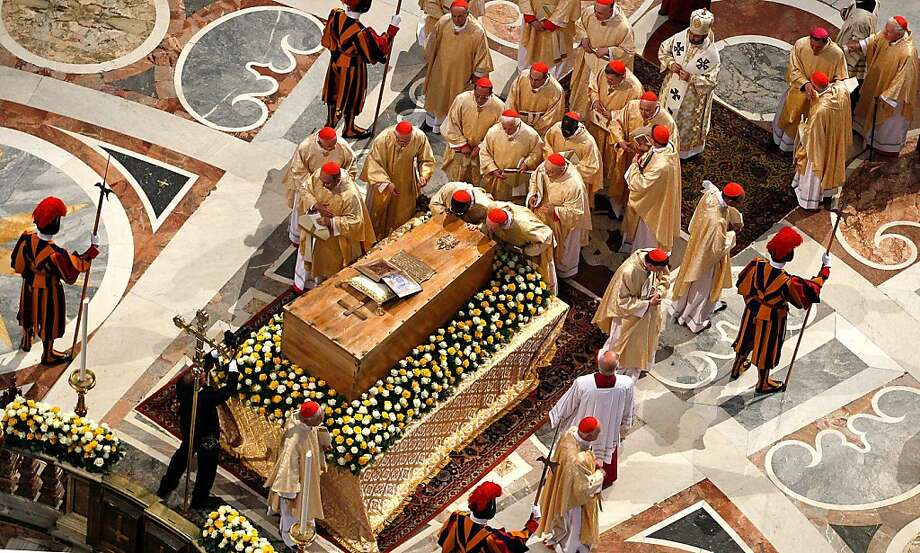 VATICAN CITY, VATICAN - MAY 01:  CardinalsI pray in front of the coffin of John Paul II at St. Peter's Basilica at the end of John Paul II Beatification Ceremony on May 1, 2011 in Vatican City, Vatican. The ceremony marking the beatification and the laststages of the process to elevate Pope John Paul II to sainthood was led by his successor Pope Benedict XI and attended by tens of thousands of pilgrims alongside heads of state and dignitaries. Photo: Pool, Getty Images