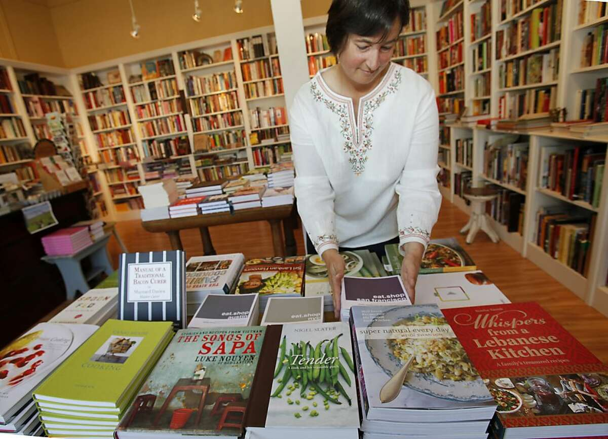 Celia Sack of Omnivore Books straightens a display with some local and new cook book authors Thursday May 5, 2011. Cook books are back in vogue and stores like Omnivore Books in San Francisco, Calif. are selling books with new and local authors.