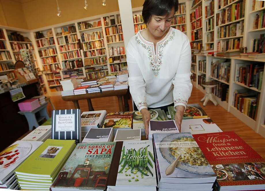 Celia Sack of Omnivore Books straightens a display with some local and new cook book authors Thursday May 5, 2011. Cook books are back in vogue and stores like Omnivore Books in San Francisco, Calif. are selling books with new and local authors. Photo: Brant Ward, The Chronicle