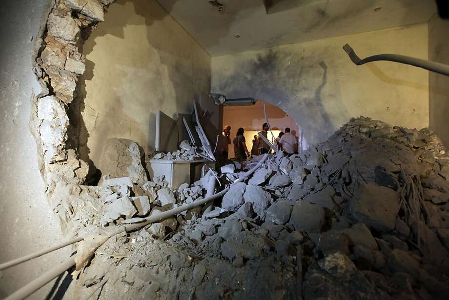 This image is on a tour organized by the Libyan government, and inspecting the damage to the Libyan leader Muammar Gaddafi house in the Area of Gargour, after an air raid in Tripoli, Libya, April 30, 2011.  Sayf al-Arab Kadhafi, embattled Libyan leader Moamer Kadhafi's youngest son, was killed in an airstrike on Saturday, a government spokesman said. Photo: Mahmud Turkia, AFP/Getty Images