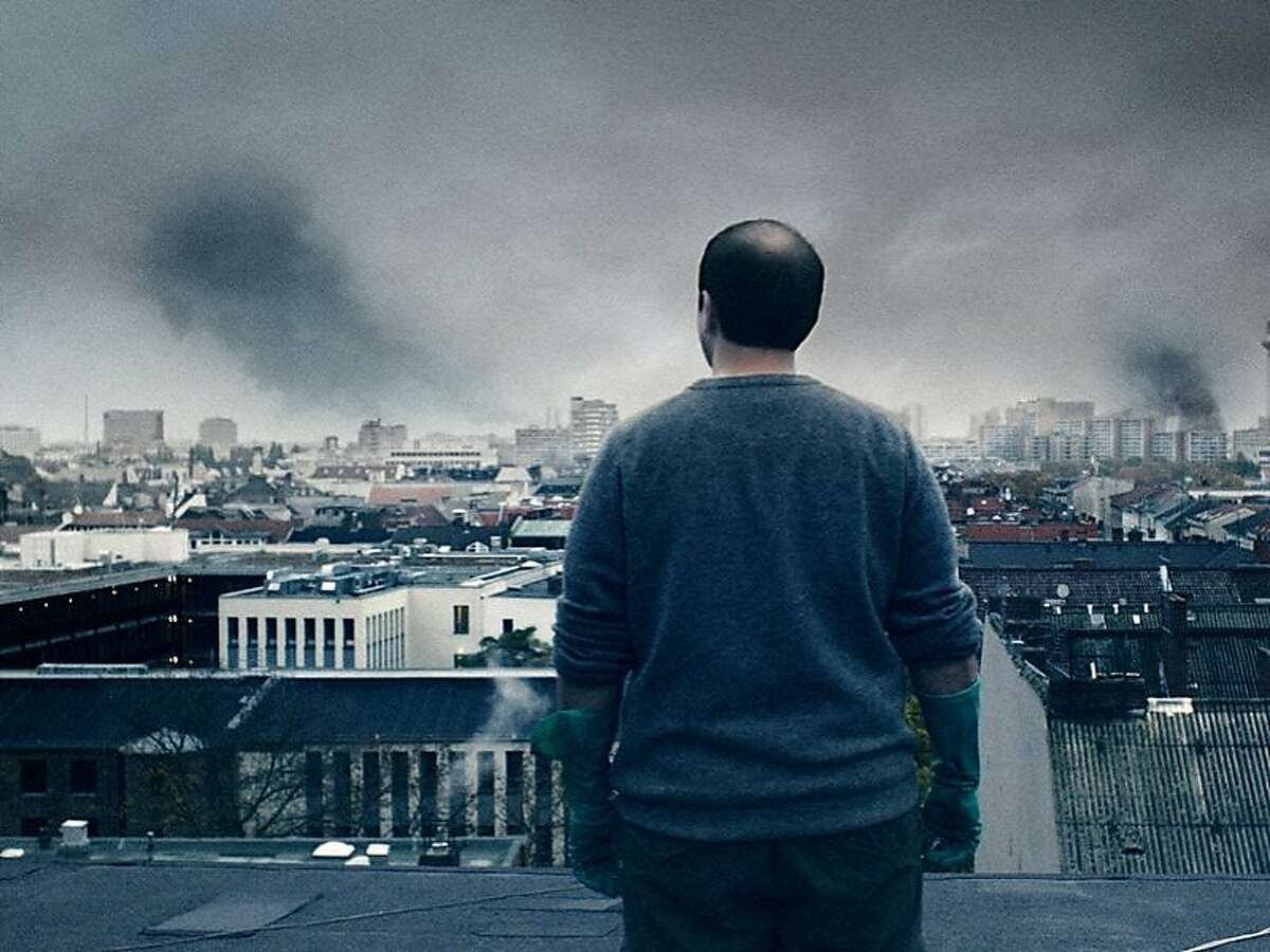 Michael (Michael Fuith) looks at a Berlin in trouble from the roof of his girlfriend's apartment building in the 2010 German zombie film