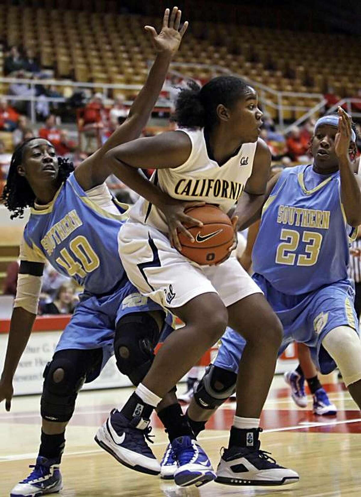 California's DeNesha Stallworth, center, grabs a rebound from Southern's Freda Allen, left, and Kimberly Griffin during the first half of an NCAA college basketball game Saturday, Nov. 28, 2009, in Columbus, Ohio. (AP Photo/Jay LaPrete)