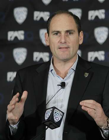 FILE - This Oct. 21, 2010, file photo shows Pac-10 commissioner Larry Scott announcing the splitting of NCAA college football divisions during a news conference in San Francisco. The Pac-10 agreed to a 12-year television contract with Fox and ESPN on Tuesday, May 3, 2011,  that will more than triple its media rights fees and be the most valuable for any conference in college sports. Photo: Paul Sakuma, Associated Press 2010